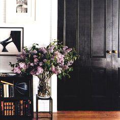 Love the contrast the doors, closet doors, black interiors, front door, black doors, white walls, black white, black interior doors, flower