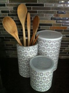 Mod podge coffee containers and baby formula cans with scrapbook paper