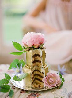 Mini metallic wedding cakes with fresh flowers. Lovely.