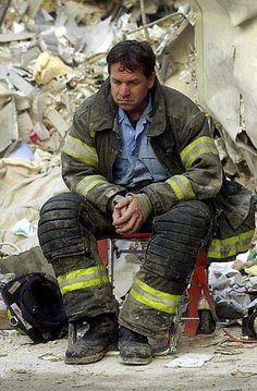 9/11 - World Trade Center. - Fireman taking a break amid the rubble...