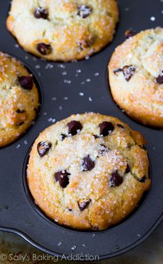 Big, bakery-style muffins stuffed with chocolate chips and topped with a sprinkle of sugar.