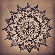 mandala tattoo on the nape of my neck