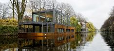Houseboat on the Eilbek Canal by german practice – Sprenger von der Lippe contemporarily designed facade - the design is a static floating residence that aligns the floor level of the living spaces with the water level.   via Brabbu Design Forces |