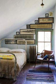 love the look of long framed pictures ! love how they are arranged in this space.