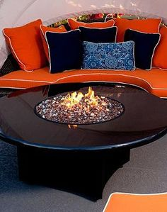 Gather your guests around the sleek Absolute Black Fire Table for a warm and inviting experience, even through the chilly fall nights.