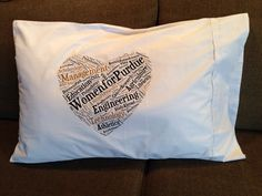 Pillow case given to participants in Women for Purdue 2014. The deans of The Deans' Bible make up the heart.