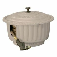 """Decorative hose reel pot in taupe. Holds up to 50' of 5/8"""" hose.    Product: Hose reel pot   Construction Material: Resin   Color: Taupe  Features:  Holds up to 50' of 5/8"""" hose    Planter design conceals hose reel inside      Dimensions: 10.25"""" H x 19.5"""" Diameter   Note: Hose not included"""