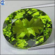 33.64cts_AAA Vivid Green_ Lustrous Pakistan Peridot_ Almost Flawless_ Oval