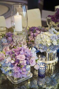 pink, blue, and white hydrangeas are accented with candles,very pretty