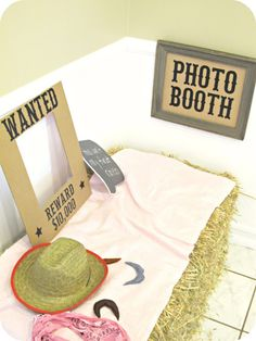 "Eeek! We could do a photo booth for you too!! How cute is that ""wanted poster"" prop!"