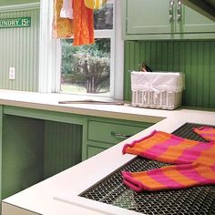 A coated-metal mesh rack set into the countertop keeps knitwear flat for drying. | Photo: Peter Rymwid | thisoldhouse.com