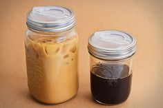 Lids to make canning jars into travel mugs. Would go nicely with my jar cozy.