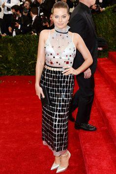 Margot Robbie wore a bespoke dress by Prada.