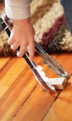 Pick up Blocks! A Fine Motor Activity Using Tongs; A motivating way for young ones to pick up their blocks & put them away, while developing fine motor skills. Perfect for 2 to 3 year olds / http://handsonaswegrow.com/block-fine-motor-toddler-activity/