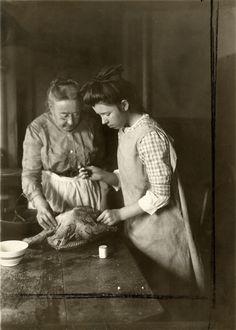 Photo of two women preparing a turkey, 1915..