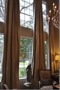 Tall windows with elegant curtains.