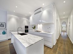 Modern galley kitchen...Marble countertops