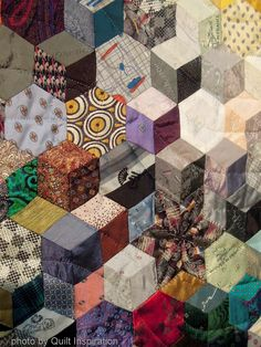 close up, Universal Ties by Nancy Ota.  Tumbling blocks quilt made with recycled mens neckties.  Photo by Quilt Inspiration