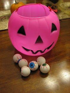 Halloween Pumpkin and Eyeball Game...bounce the eyes(ping pong balls) into the bucket