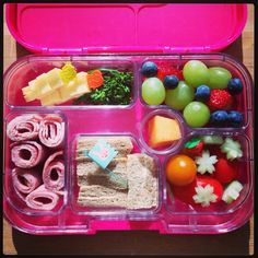 Rye bread w/ Nuttelex, Bangalow ham roll-ups, dairy-free cheese skewers, steamed baby broccoli, grapes, berries & melon, cherry tomatoes & cucumber 'flowers'. #yumbox lunchbox idea
