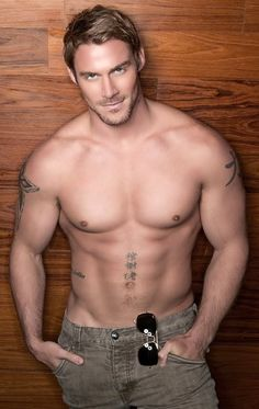 Kinda what I picture Christian Grey looking like... minus the tattoos