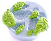 Leaf Silicone Mold - Create 3 Leaves - Lily style - Fondant Leaf Mold - Candy Leaf Mold - Sugarcraft Leaf Mold. $7.00, via Etsy.