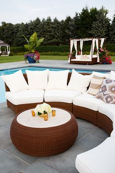 A white wicker lounge area is ideal for creating a luxurious, yet comfortable outdoor lounge area.
