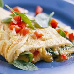 Spinach and Cheese Omelet  Cayenne pepper and chives spice   up the eggs in this fresh omelet; baby spinach leaves and red peper relish add a healthy flavor twist