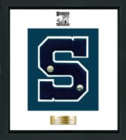 Staples High School in Connecticut Varsity Letter Frame - Showcase your varsity letter in our Omega solid hardwood shadowbox frame in black satin finish with hand embossed Staples High School logo, on our white and navy museum quality matting. A personalized engraved plate is included.