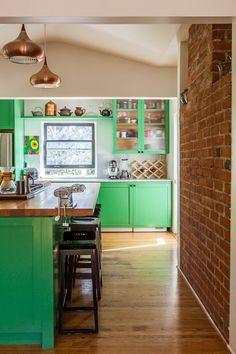 Green + Copper color combination in a California kitchen. Exposed brick