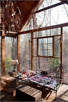 Glass with wrought iron bed to keep it strong but not heavy looking. Makes me want to put the long day of work behind me and relax with a glass of wine and a good book in this beautiful glass room!