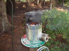Construct this tin can stove (also known as a rocket stove) using only three tin cans.