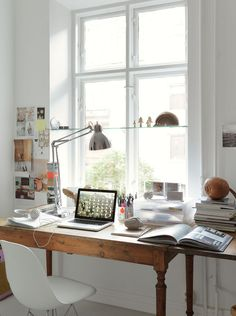 wood desk, inspiration wall & bright light