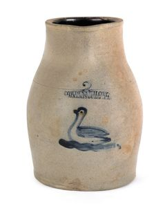 "Sold For $ 2,200         	   	        	   	           	      	                  Cowden & Wilcox, Harrisburg, Pennsylvania two-gallon stoneware pitcher, 19th c., with a cobalt swan decoration, 12 1/2'' h.                            Condition report           Repaired break to handle. 4"" sprayed hairline. 5"" area of rim sprayed. Stone pop to mid body. Sporadic filled in and sprayed flakes to body."