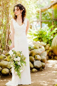The bridal bouquet, looking as if the bride gathered a bunch of wildflowers from the gardens herself. Big Sur Flowers. Jade Turgel Photography.