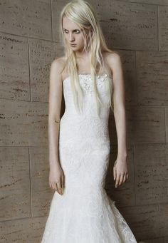 Look 11. Ivory strapless mermaid gown with hand appliqué lace, flower embroidery and silk organza crescent technique.