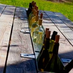 Love!! Take the middle board out of your picnic table. Replace with an old rain gutter and make an instant wet bar!!