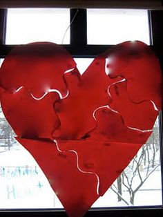 Healing Heart activity for grief/loss related groups    - Make a big heart, cut it apart, have students draw/write on it, and then put it together like a puzzle with band-aids