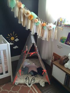Reading Tent + Floral Tassel Garland - what a fun whimsical place for child's imagination to run wild!