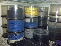 Recycle CD containers to store cables.