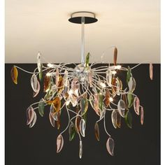 A fun alternative to a traditional crystal ceiling light. Multicolored glass leaves make this chandelier sparkle. From http://www.lampsplus.com/products/possini-euro-vibrant-leaves-of-light-29-inch-wide-chandelier__12251.html