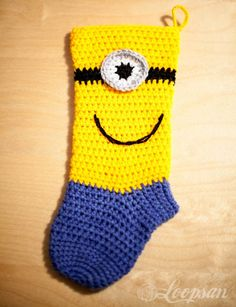 Minion-inspired Christmas Sock - Free Pattern - Loopsan- Wish I had seen this before Christmas-Oh well, maybe it will still be popular next year!