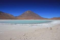 Laguna Verde, Bolivia -  Uyuni won out because nothing can prepare you for riding over its swathes of white salt, baked hard under a fantastically blue sky. This is a landscape just waiting for your imagination to paint it. Moreover, there is a bonus in the title - salt FLAT. The ride can be done in a day, which is probably advisable as nighttime temperatures sink to around -20°C (-4°F). Make sure you have fat tyres not road ones.
