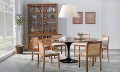 Tok&Stok Jantar Um encontro de estilos: Mesa de Eero Saarinen, cadeiras e buffet de Guilherme Bender