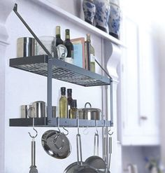 Wall shelf and pot rack. I need this.