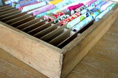 Old cassette organizer for fabric scraps....but what about different tissue paper colors, sticker sheets. . . paper scraps too!