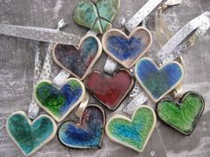 Clay hearts - add edge, wire for hanging, and place glass marbles or chips on during glaze firing