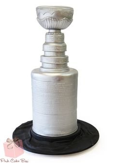 We created this Stanley cup cake for a client who is a huge Ranger's fan and wanted to celebrate their Stanley cup run this year!  (Yes the didn't win, but it was a great season for the team).    The end result was this multi-tier Stanley cup cake!