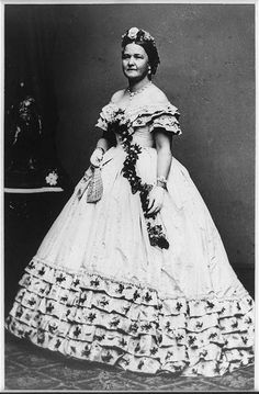 Mary Todd Lincoln, full-length portrait showing the majestic gown. Note she is wearing her favorite seed pearl necklace and bracelets.  (s.