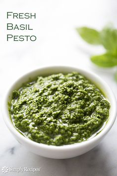 Basil Pesto on SimplyRecipes.com, the best use for summer garden basil that's outgrowing the beds! Perfect with pasta or smeared on crackers and crostini #dip